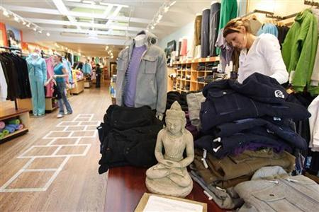 A buddha statue sits at the entrance of Lululemon Athletic, a yoga clothing store, as a women shop with her dog in San Francisco, California, in this March 31, 2006 file photo.REUTERS/Kimberly White/Files
