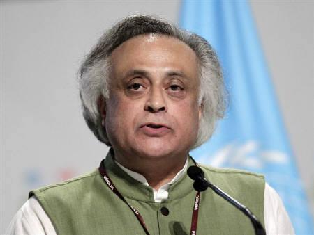 Environment Minister Jairam Ramesh gives a speech during a plenary session at the Moon Palace, where climate talks are taking place, in Cancun, December 8, 2010. REUTERS/Henry Romero