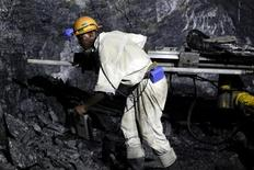 <p>A mine worker is seen underground in South Deep mine outside Johannesburg June 4,2010. REUTERS/Siphiwe Sibeko</p>