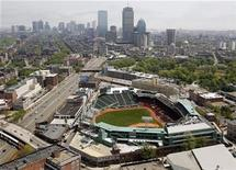 <p>Fenway Park, home of the Boston Red Sox, is seen in front of the Boston, Massachusetts skyline May 16, 2009. REUTERS/Brian Snyder</p>