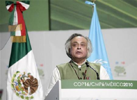 India's Environment Minister Jairam Ramesh gives a speech during a plenary session at the Moon Palace, where climate talks are taking place, in Cancun, December 8, 2010. REUTERS/Henry Romero