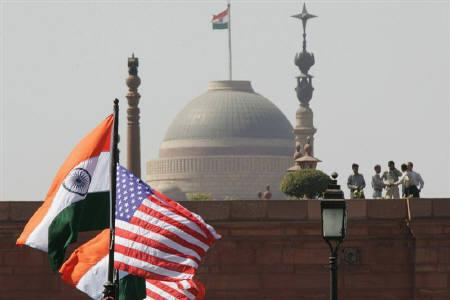 Indian and U.S. national flags flutter in front of the Presidential Palace, in New Delhi February 28, 2006. REUTERS/B Mathur/Files