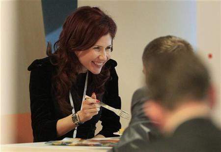 Former Russian spy Anna Chapman smiles during a meal after a meeting of the commission on economic modernization and technological development of the Russian economy, at Skolkovo Innovation Centre outside Moscow December 14, 2010. REUTERS/Sergei Karpukhin (RUSSIA - Tags: POLITICS SCI TECH)