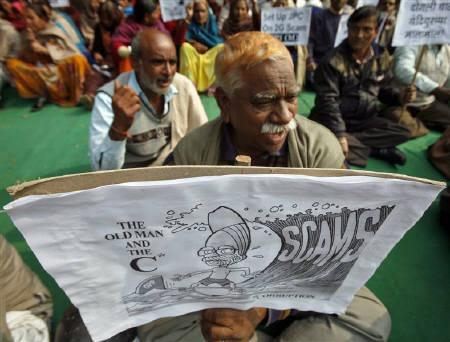 Activists of Communist Party of India Marxist CPI (M) hold a cartoon placard portraying  Prime Minister Manmohan Singh during a protest against the telecom corruption scandal in New Delhi December 10, 2010. REUTERS/Parivartan Sharma/Files