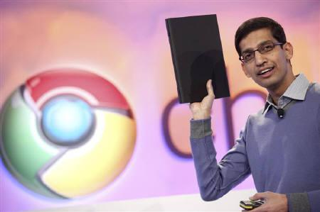 Sundar Pichai, vice president of product management for Google, holds a netbook that runs the company's Chrome OS during the company's event in San Francisco December 7, 2010. REUTERS/Beck Diefenbach/Files