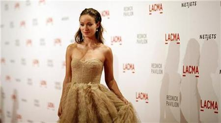 Actress Olivia Wilde poses at the gala for the opening of the Lynda and Stewart Resnick pavilion at the Los Angeles County Museum of Art (LACMA) in Los Angeles September 25, 2010. REUTERS/Mario Anzuoni