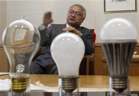 Toshiba Corp President and CEO Norio Sasaki speaks behind a display of Toshiba light bulbs during an interview with Reuters at the company headquarters in Tokyo December 16, 2010. Toshiba Corp may see profit in its liquid-crystal display business recover to more than 10 billion yen ($119 million) for the year to March, compared with its previous forecast of zero, Sasaki said on Thursday. REUTERS/Toru Hanai