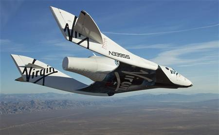 The Virgin Galactic SpaceShip2 (VSS Enterprise) glides toward Earth on its first test flight after being released from its WhiteKnight2 (VMS Eve) mothership over Mojave, California October 10, 2010. REUTERS/Mark Greenberg-Virgin Galactic/Handout (UNITED STATES - Tags: SCI TECH TRANSPORT)