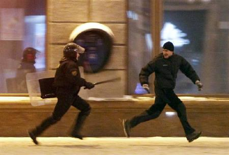 A riot policeman chases an opposition protester during a rally denouncing the results of presidential elections in central Minsk December 19, 2010.  REUTERS/Gleb Garanich