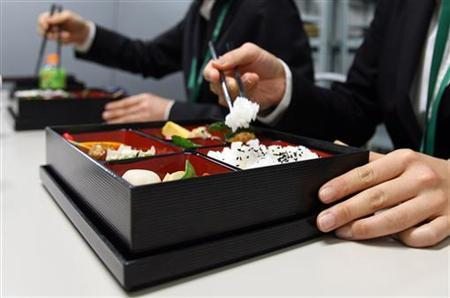 Support staff at the G20 meeting on climate change use reusuable chopsticks to eat from traditional reusable ''bento'' boxes during their lunch break in Chiba, near Tokyo in this March 15, 2008 file photo. REUTERS/Yuriko Nakao