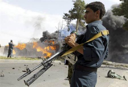 An Afghan policeman keeps watch at the site of a blast in Herat August 8, 2010.  REUTERS/Mohammad Shoib/Files