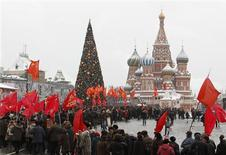 <p>Russian communists walk along the Red Square in Moscow December 21, 2010, on their way to attend a wreath-laying ceremony to mark the 131th anniversary of Soviet dictator Josef Stalin's birthday at his grave at the Kremlin wall. REUTERS/Denis Sinyakov</p>