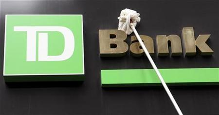 A window washer cleans the sign on a TD Bank in New York's financial district in this May 1, 2009 file photo. REUTERS/Brendan McDermid