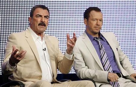 Co-stars Tom Selleck (L) and Donnie Wahlberg talk about their show ''Blue Bloods'' during the CBS, Showtime and the CW Television Critics Association press tour in Beverly Hills, California, July 28, 2010. REUTERS/Lucy Nicholson