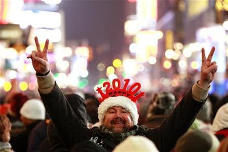 A reveller gestures during New Year's Eve celebrations in New York's Times Square December 31, 2009. REUTERS/Lucas Jackson