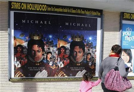 Posters promoting the launch of a posthumous Michael Jackson album titled 'Michael' are pictured in Hollywood December 8, 2010. REUTERS/Fred Prouser