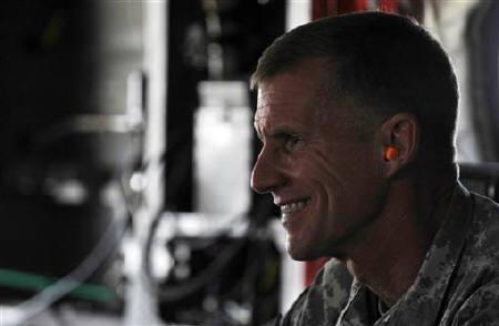 File photo of former U.S. General Stanley McChrystal wearing earplugs as he leaves by helicopter after a meeting between Afghan President Hamid Karzai and tribal leaders in Kandahar city June 13, 2010. REUTERS/Massoud Hossaini/Pool/Files