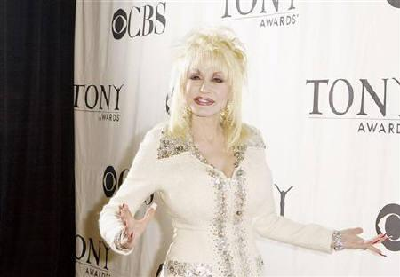 File photo of Singer Dolly Parton arriving for a press reception in New York May 6, 2009. REUTERS/Lucas Jackson/Files