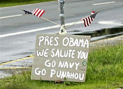 A sign placed near Marine Corps Base Hawaii in Kaneohe welcomes U.S. President Barack Obama to Hawaii December 26, 2010. The words ''Go Punahou'' is a reference to the school Obama attended in Hawaii. Picture taken through a car window. REUTERS/Kevin Lamarque