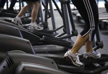 Clients work out on machines at the Bally Total Fitness facility in Arvada, Colorado in this June 15, 2009 file photo. REUTERS/Rick Wilking