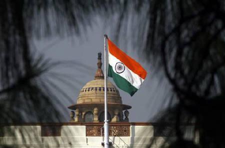 The national flag flutters on top of the Indian parliament building in New Delhi December 1, 2010. The speaker of the parliament will meet all political parties on Thursday to try resolve an impasse that threatens to  deadlock the February budget session of parliament ,  a senior opposition leader said. REUTERS/B Mathur/Files