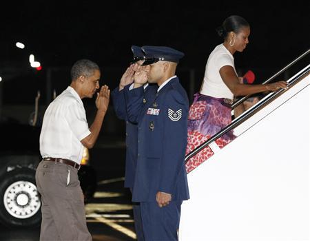 President Barack Obama and first lady Michelle Obama board Air Force One before departing from Honolulu January 3, 2011. REUTERS/Kevin Lamarque