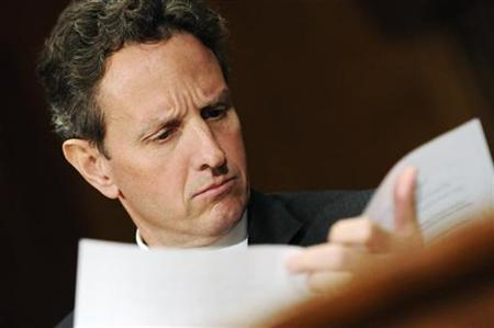 Treasury Secretary Timothy Geithner reads his notes as he arrives to testify on Capitol Hill, December 16, 2010. REUTERS/Jonathan Ernst