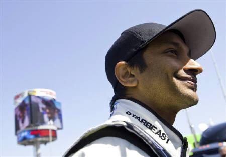 Narain Karthikeyan of India speaks with a reporter (not pictured) before the start of the NASCAR Camping World Truck Series Kroger 250 at Martinsville Speedway in Martinsville, Virginia March 27, 2010. REUTERS/Chris Keane/Files