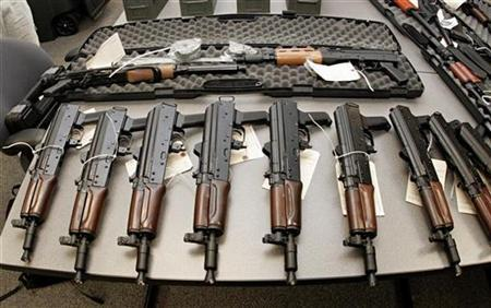 AK-47 short pistols, part of a weapons shipment seized by the Bureau of Alcohol, Tobacco, Firearms and Explosives (ATF), are laid out on a table at the bureau's Arizona headquarters in Phoenix, Arizona January 14, 2008. REUTERS/Jeff Topping