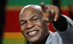 "<p>Former heavyweight champion Mike Tyson smiles as he gestures at a panel for the Animal Planet documentary ""Taking on Tyson"" during the Discovery Networks Television Critics Association winter press tour in Pasadena, California January 6, 2011. REUTERS/Mario Anzuoni</p>"