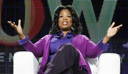 Oprah Winfrey answers a question at a panel during the Oprah Winfrey Network (OWN) Television Critics Association winter press tour in Pasadena, California January 6, 2011. REUTERS/Mario Anzuoni