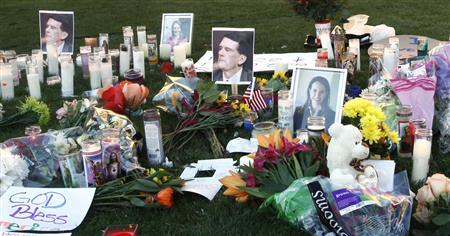 A makeshift memorial outside the hospital where the victims of Saturday's shooting is seen in Tucson, Arizona January 9, 2011. REUTERS/Rick Wilking