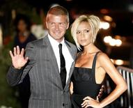 <p>Los Angeles Galaxy's David Beckham waves beside his wife Victoria at a party at the Museum of Contemporary Art in Los Angeles, July 22, 2007. Actor Tom Cruise and his wife Katie Holmes hosted a party for the Beckhams on Sunday. REUTERS/Mario Anzuoni</p>