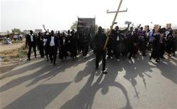 <p>Christians join a parade in support of the referendum on south Sudan independence in Juba, January 9, 2011. REUTERS/Thomas Mukoya</p>