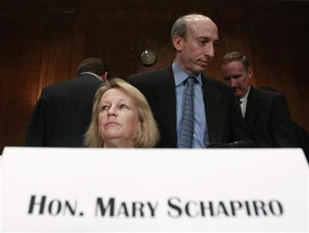 U.S. Securities and Exchange Commission Chairman Mary Schapiro and Commodity Futures Trading Commission Chairman Gary Gensler arrive to testify before a Senate Banking Housing and Urban Affairs Securities, Insurance, and Investment Subcommittee hearing on ''Examining the Causes and Lessons of the May 6 Market Plunge,'' on Capitol Hill in Washington May 20, 2010. REUTERS/Jim Young