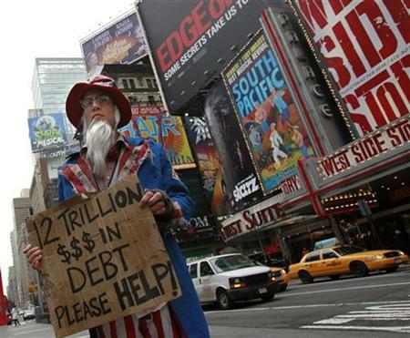 A man dressed as a destitute Uncle Sam begging for $12 trillion demonstrates in New York January 19, 2010. REUTERS/Brendan McDermid