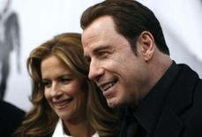 <p>Actor John Travolta (R) and his wife Kelly Preston in New York January 28, 2010. REUTERS/Jessica Rinaldi</p>