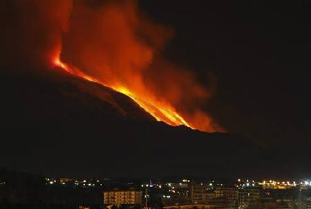 Mount Etna spews lava on the southern Italian island of Sicily January 13, 2011. Mount Etna is Europe's tallest and most active volcano. REUTERS/Antonio Parrinello