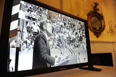 <p>A video of President John F. Kennedy plays during the launch a new online trove of his official and personal records at the National Archives in Washington, January 13, 2011. REUTERS/Jonathan Ernst</p>