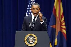"<p>President Barack Obama speaks during the ""Together We Thrive: Tucson and America"" event held to support and remember the victims of Saturday's mass shooting, at the University of Arizona in Tucson, Arizona, January 12, 2011. REUTERS/Mike Segar</p>"