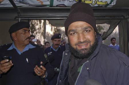 Malik Mumtaz Hussain Qadri, a man identified as a guard of governor of Punjab province Salman Taseer, smiles after being detained at the site of Taseer's shooting in Islamabad January 4, 2011. REUTERS/Saaf-ur-Rahman