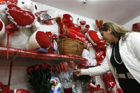 An Iraqi woman shops for a gift for Valentine's Day in Baghdad February 14, 2010. Neighbouring Iran, according to media reports, has banned the production of Valentine's Day gifts and any promotion of the day celebrating romantic love to combat what it sees as a spread of Western culture. REUTERS/Thaier al-Sudani/Files
