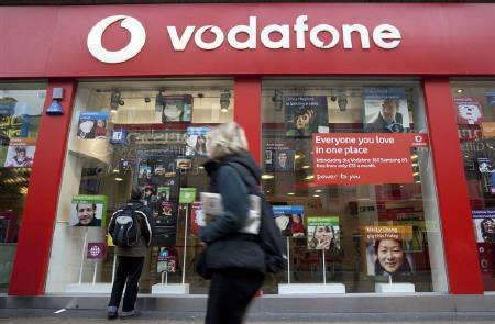 A pedestrian passes a Vodafone store on Oxford Street in central London, November 10, 2009. REUTERS/Kevin Coombs/Files