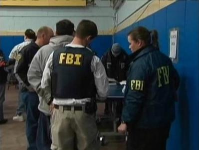 Federal Bureau of Investigation (FBI) agents arrest more than 100 organized crime suspects in New York, in this still image taken from WNBC-TV video footage from early January 20, 2011. REUTERS/WNBC-TV