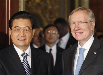 China's President Hu Jintao (L) meets with U.S. Senate Majority Leader Harry Reid (D-NV) prior to a meeting with senators on Capitol Hill in Washington January 20, 2011. REUTERS/Jason Reed