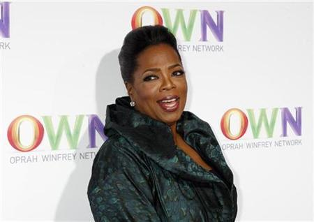 Talk show host Oprah Winfrey poses at the OWN: Oprah Winfrey Network launch cocktail reception for the Television Critics Association winter press tour in Pasadena, California January 6, 2011. REUTERS/Fred Prouser