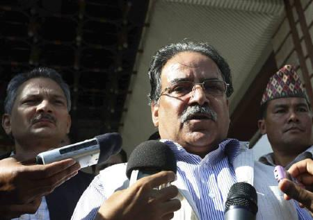 Communist Party of Nepal (Maoist) Chairman Puspha Kamal Dahal ''Prachanda'' (C), flanked by Vice Chairman Baburam Bhattarai (L), speaks to the media in Kathmandu July 20, 2010. REUTERS/Shruti Shrestha/Files