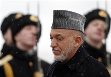 Afghanistan's President Hamid Karzai inspects the guard of honour during a welcoming ceremony after arriving on an official visit at Moscow's Vnukovo airport, January 20, 2011. REUTERS/Denis Sinyakov