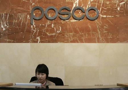 An employee of POSCO, South Korea's largest steel maker, works at the company's headquarters in Pohang, about 370 km (230 miles) south of Seoul, February 25, 2009. REUTERS/Jo Yong-Hak/Files