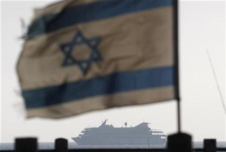 An Israeli flag flutters in the wind as a naval vessel (not seen) escorts the Mavi Marmara, a Gaza-bound ship that was raided by Israeli marines, to the Ashdod port May 31, 2010. REUTERS/Amir Cohen